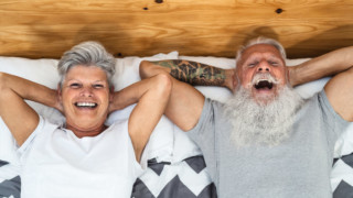 healthy mature couple putting positive feelings out into the universe