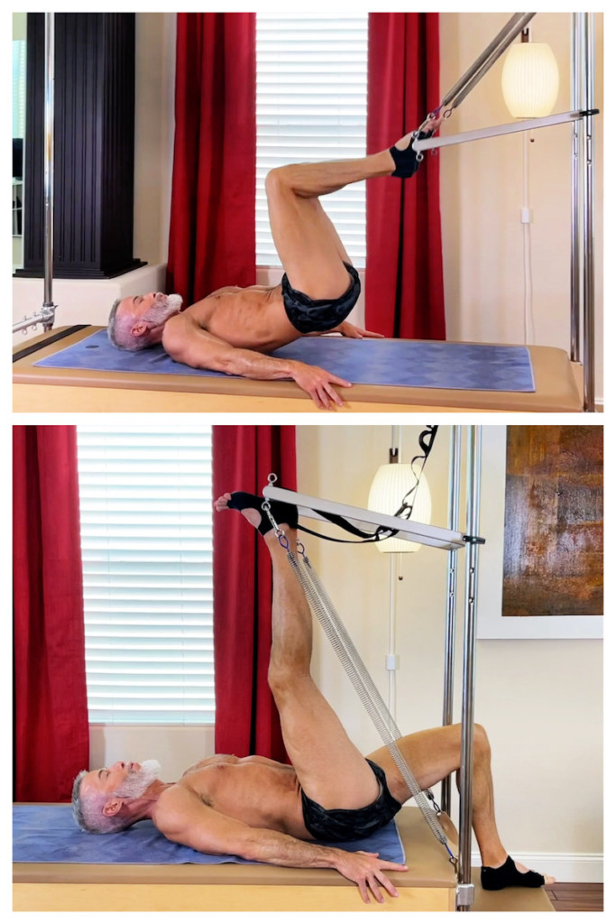 male mature athlete doing pilates leg exercises on the trap table